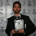 Anton Emdin with the plaque for Best Magazine Illustration.