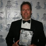 Dave Whamond with his plaque for advertising illustration.